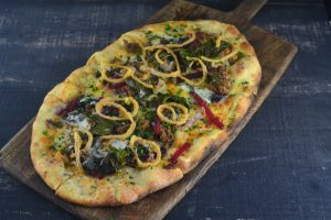 Boar Sausage Flatbread with Pickled Beets, Fried Shallots, Collard Greens, Red Dragon Cheddar at Ad Lib in Harrisburg