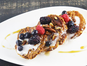Cinnamon Roll French Toast with fresh berries. Breakfast at Ad Lib in Harrisburg.