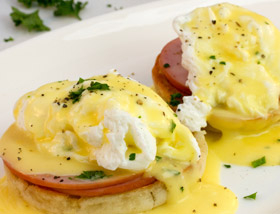 Classic Eggs Benedict with English Muffin, Canadian Bacon, Hollandaise, Breakfast Potatoes. Breakfast at Ad Lib in Harrisburg.