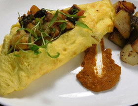Gumbo Omelet with Rock Shrimp, Andouille Sausage, Okra, Tomato, Creole Sofrito. Brunch at Ad Lib in Harrisburg.