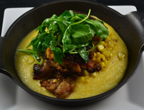 Blackened Salmon Cakes with Cheddar Grits, Crumbled Sausage, Corn, Arugula. Brunch at Ad Lib in Harrisburg.