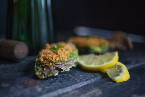 Baked Oysters with Crab, Lobster, Spinach.