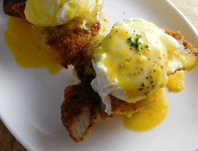 Southern Eggs Benedict with Buttermilk Biscuit, Fried Chicken Cutlet, Poached Egg, Tabasco Hollandaise, Ghost Pepper Cheese, Breakfast Potatoes. Brunch at Ad Lib in Harrisburg.