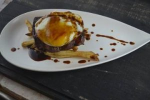 Steak & Eggs with 6 oz Prime Flat Iron, Herbed Fries, Sunny Side Egg, Demi-Glace at Ad Lib Restaurant in Harrisburg